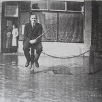 Mr Ingarfill outside Stevenage Road Butchers 1968 Flood