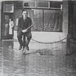 Mr Ingarfill outside Stevenage Road Butchers 1968 Flood